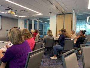 attendees listening at seminar